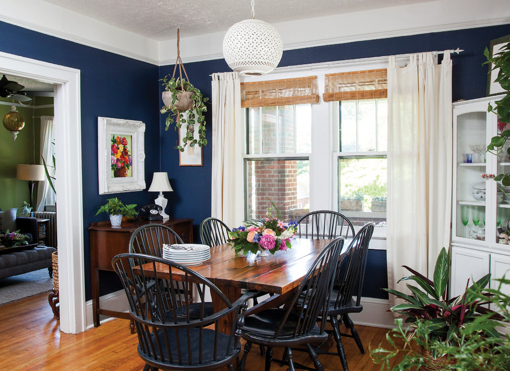 Some furnishings were sourced from yard sales, including the dining room table and $2 pendant above, which Thomas painted white and made into a light.