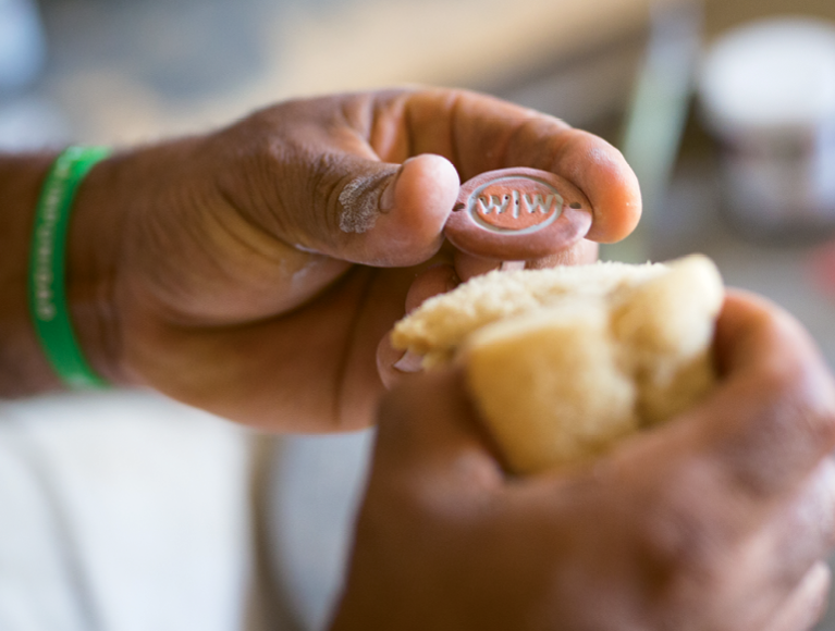 Seal of Approval - The clay stamp designed and made by Wine to Water's Dominican Republic Master Ceramicist, Radhames Carela, is used to brand their filters.