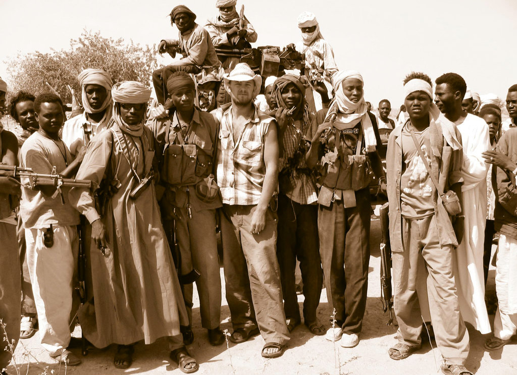 Mission Impossible In 2004 at age 25, Doc Hendley (center) spent a year in the midst of the Darfur Genocide, offering humanitarian aid.