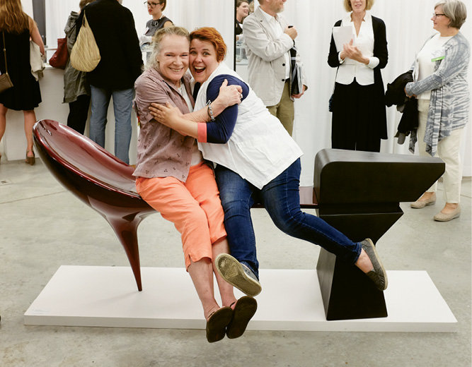 Contributing artists Elizabeth Brim and Vivian Beer pose with Beer's auction piece.