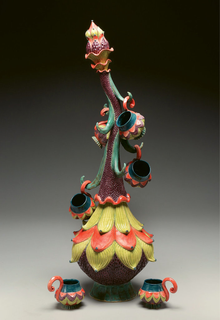 """Sherburne's """"mug tree,"""" with its curving stalk, creatively stores a collection of cups."""