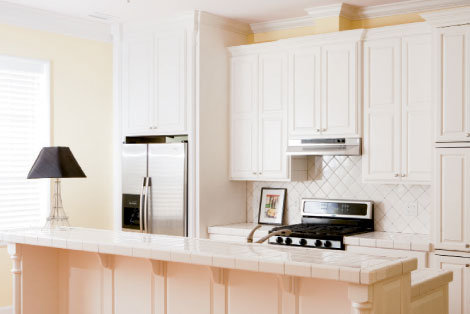Custom ash cabinetry, crown molding, and tiles give the kitchen a 1930s look