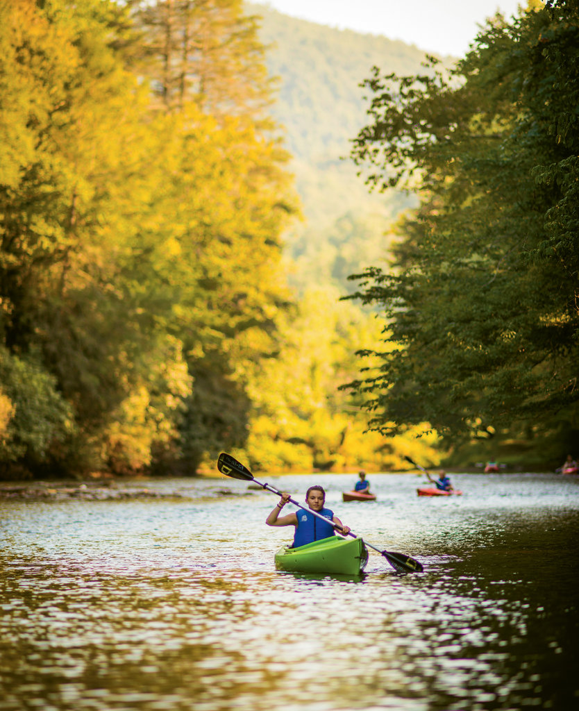 Kayakers take in a tranquil stretch of the river in Transylvania County.